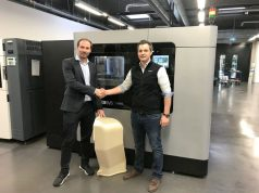 André Bialoscek Head of Vehicle Physical Integration Hennigsdorf, Bombardier, holding a 3D printed Air Duct, and Dominik Mueller, Strategic Account Manager at Stratasys